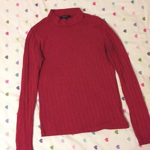 Red ribbed knit turtleneck top